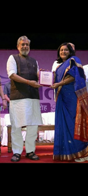 Amrita Singh Awarded by Deputy Chief Minister of Bihar, Sushil Modi for Mensturation Awarness Work in Bihar.jpg