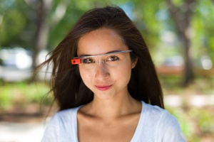 Google executive Amanda Rosenberg modeling the Google Glass face mounted wearable computer.